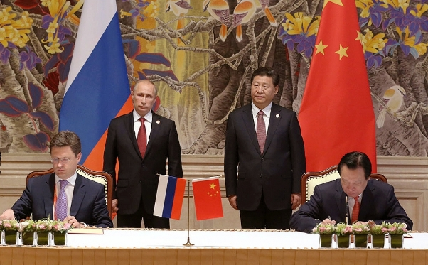 Xi Jinping and Vladimir Putin attend the signing of the China and Russia Purchase and Sales Contract on East Route Gas Project and a memorandum in Shanghai.